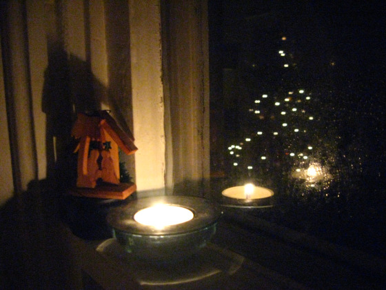 Reflected Christmas tree and candle